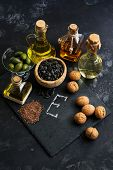 Food With Vitamin E. Set Of Oils, Olive Oil,linseed Oil , Sunflower Oil, Walnut Oil. Concept poster