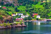 Norwegian Fjord Village And Sognefjord Landscape In Flam, Norway. Tourism Vacation And Travel Backgr poster