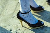 Shoe Concept. High Heel Shoes On Female Feet. Shoe Fashion. Shoes Designed To Move On poster