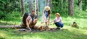 Hike Barbecue. Friends Enjoy Weekend Barbecue In Forest. Company Friends Picnic Or Barbecue Roasting poster