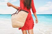 Beach bag vacation woman walking carrying things on tropical holidays holding tote purse for summer  poster