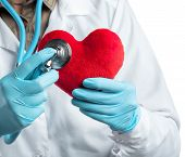 Female Cardiologist In Uniform Holding Red Heart Isolated On The White Background poster