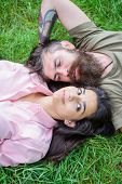 Couple In Love Relaxing Lay At Meadow. Nature Fills Them Freshness And Peace. Hipster Bearded Man An poster
