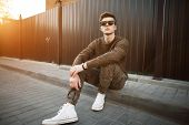 Handsome Fashion Hipster Man In Stylish Sunglasses In A Fashionable Pullover And Military Stylish Pa poster