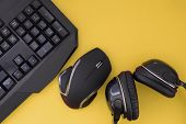 Flat Lay Gamer Background. Mouse, The Keyboard, The Headphones Are Isolated On A Yellow Background,  poster