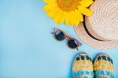 Fashion Flatlay With Sunglasses, Espaddrille Sandals, Straw Boater Hat And Bright Big Yellow Sunflow poster