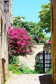 stock photo of illuminati  - Medieval street in Old city of Rhodes island - JPG