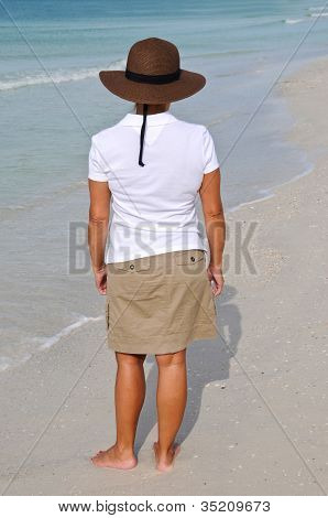 Attractive Woman Standing On The Beach