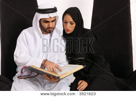 Arabian Couple Reading Islamic Text