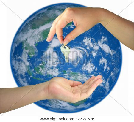 Two Woman Hands Giving Key From The Earth Isolated Over White