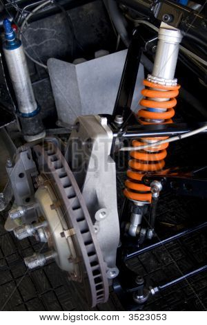 Race Car Brake Disk And Orange Shock Absorber