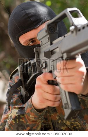 Soldier In Black Mask With A Gun