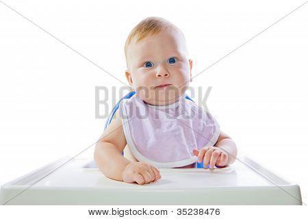 A Young Blue-eyed Child Feeding Pumpkin Puree