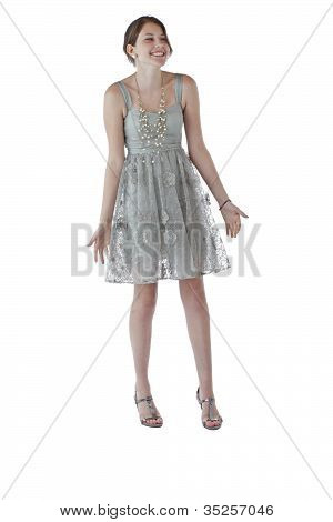 Teenage Girl In Lace Party Dress Laughs And Shrugs