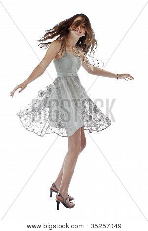 Teenage Girl Twirls In Lace Party Dress