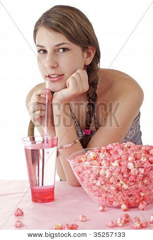 Smiling Teen Girl With Pink Popcorn