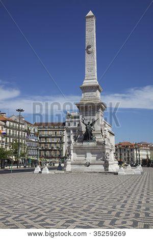 Stock Photo Obelisk at  Restauradores Square Lisbon