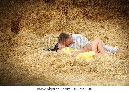 A Couple In Kissing At Hay