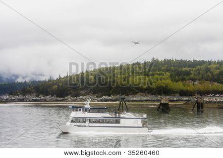 Plane Landing Over Ferry In Alaska