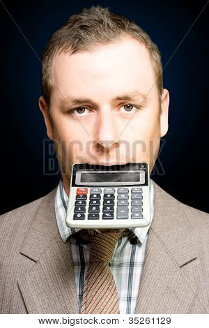 Accountant Number Crunching On Calculator