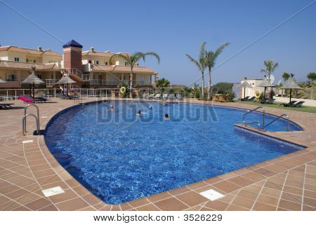 People In Swimming Pool Of Holiday Apartments