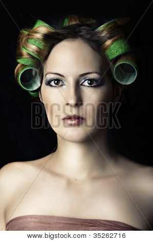 Young Beautiful Woman With Hair Rools