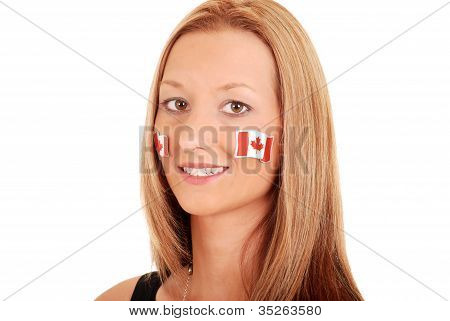 Young woman with canada stickers on face