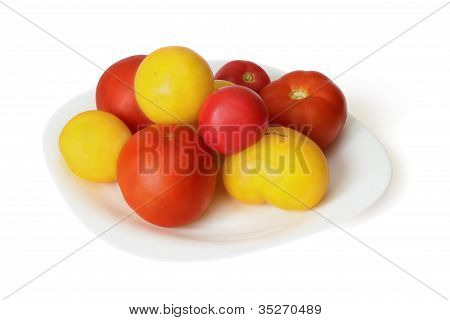 Red and yellow tomato on dish