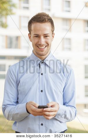 Smiling Businessman With Smartphone