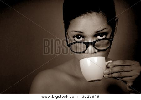 Woman Sips Coffee