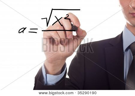 Teacher writing a mathematical equation