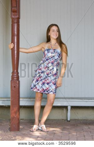 Girl By Red Pole