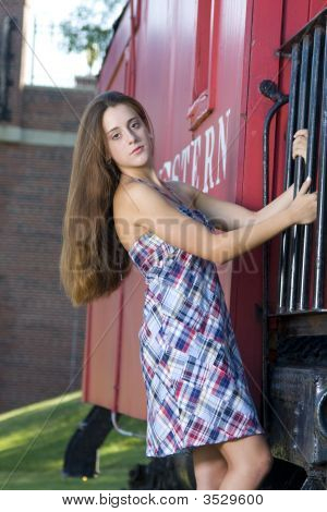 Pretty Girl Standing On The Steps Of A Red Caboose