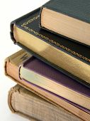 picture of illiteracy  - Closeup of stacked books on an isolated white background - JPG