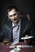 foto of sharpie  - Young adult handsome business man winner playing poker - JPG