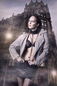 picture of sado-masochism  - Sexy woman in leather jacket and skirt in the city - JPG