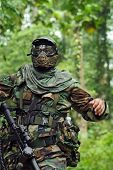 stock photo of gun shot wound  - Picture of paintball player running from enemy - JPG