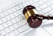 stock photo of judiciary  - Close up of wooden gavel at the computer keyboard - JPG