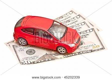 Toy Car And Money Over White. Rent, Buy Or Insurance Car Concept