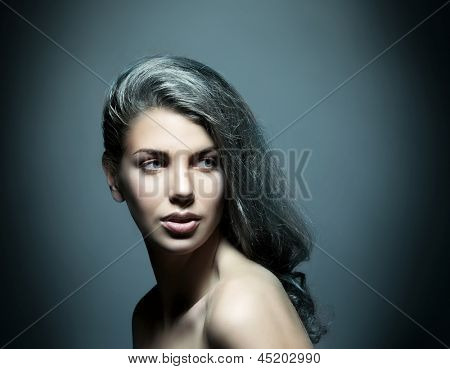 Blue gamma portrait of young and beautiful woman