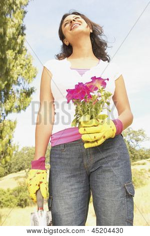 Low angle view of woman gardening