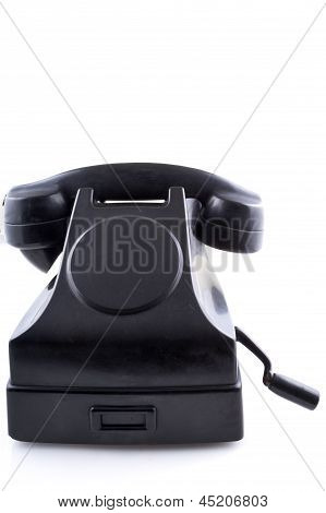 Old black vintage telephone,  white background
