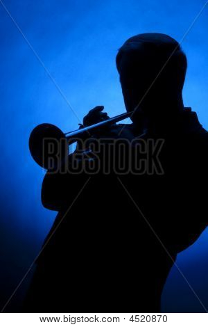 Trumpet Player Silhouette On Blue