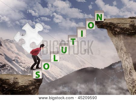 Businessman Bring Puzzle Solution To Mountain Top