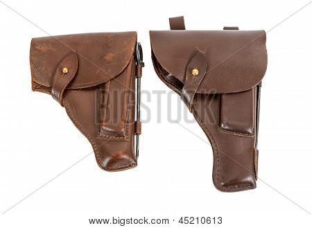 Two Handgun Holsters Isolated On White Background