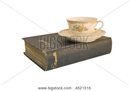 Etiquette Book And Tea Cup