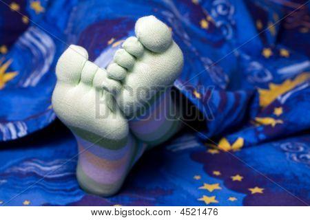 Feet In Funny Striped Socks