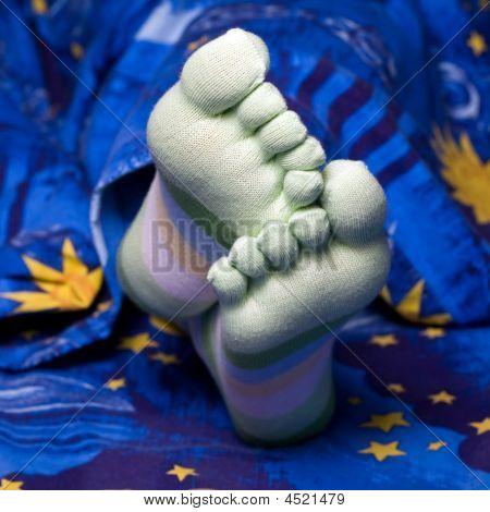 Feet In Striped Socks