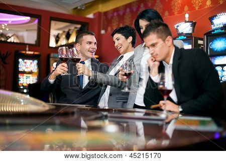 Excited couple and sad couple gambling in casino, bad luck