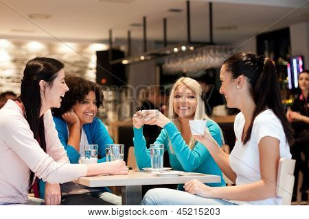 group of young women on coffee break, enjoying in discussion